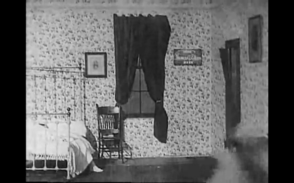 "Just what your bedroom's missing! The picture to the right of the window reads ""Thomas A. Edison"" (""Life of an American Firman"" 1903)."